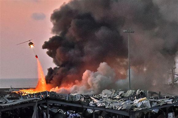 BILLEDSERIE: Havnen i Beirut uigenkendelig efter eksplosion