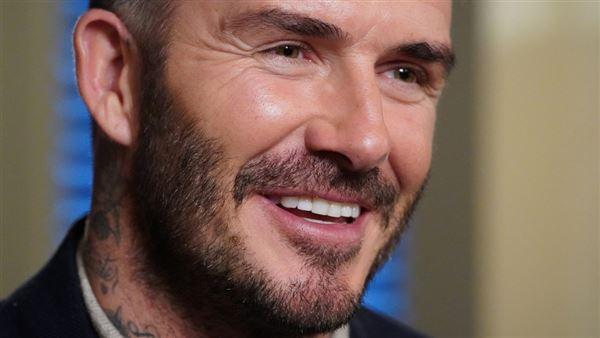 Billede af en bredt smilende David Beckham
