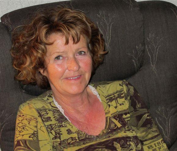 den forsvundne norske milliardærfrue Anne-Elisabeth Hagen i grønlig trøje