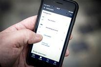 Mobiltelefon med kørekort-app