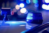 Blå blink på taget af politibil