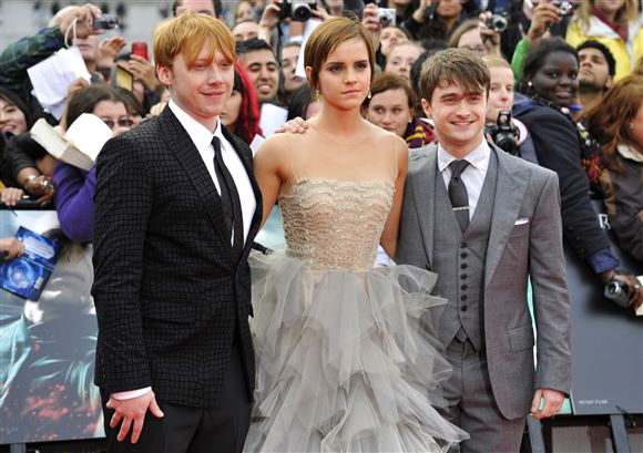 Rupert Grint, Emma Watson og Daniel Radcliffe på den røde løber.