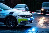 En politibil og en adspærring