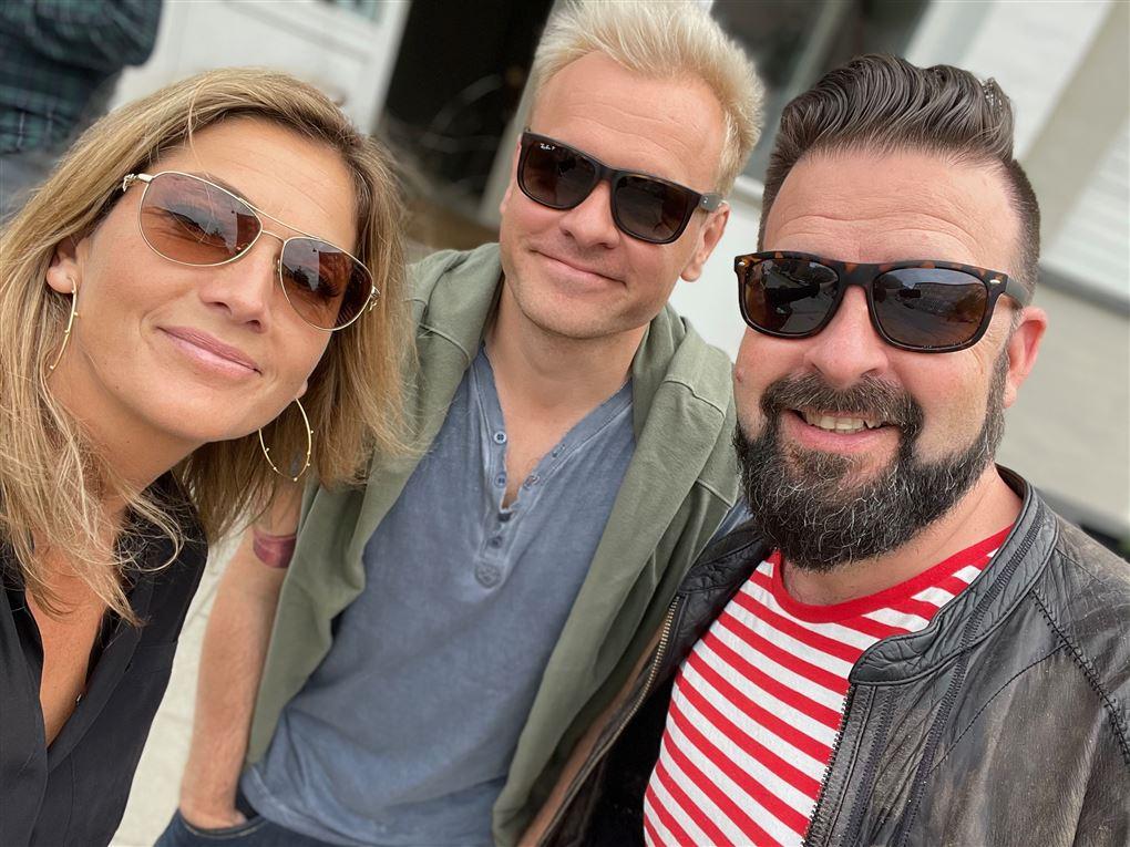 Tre personer, en dame og to mænd, med solbriller